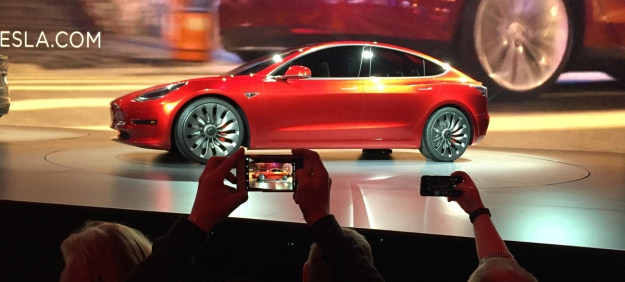 CORRECTS SPELLING OF PHOTOGRAPHER'S LAST NAME TO PRITCHARD, NOT PRICHARD - Tesla Motors unveils the new lower-priced Model 3 sedan at the Tesla Motors design studio in Hawthorne, Calif., Thursday, March 31, 2016. It doesn't go on sale until late 2017, but in the first 24 hours that order banks were open, Tesla said it had more than 115,000 reservations. Long lines at Tesla stores, reminiscent of the crowds at Apple stores for early models of the iPhone, were reported from Hong Kong to Austin, Texas, to Washington, D.C. Buyers put down a $1,000 deposit to reserve the car.  (AP Photo/Justin Pritchard)